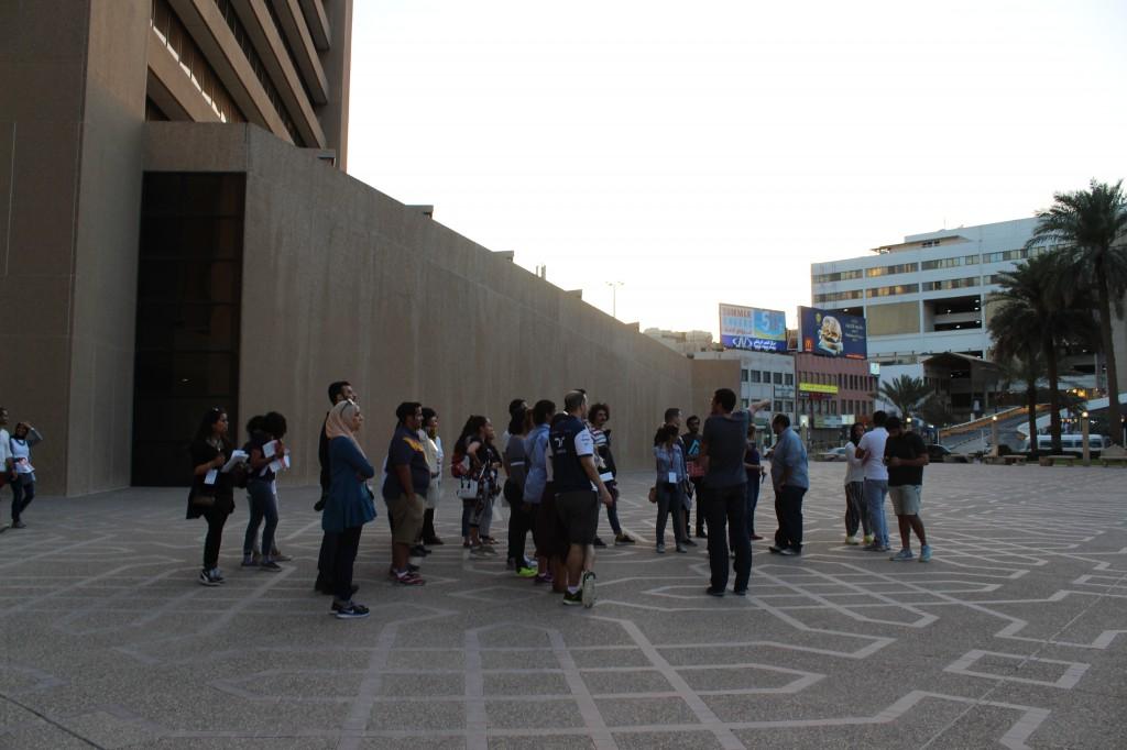 AGi tour guide Ali Al Yousifi discusses the design of the Banks Complex plaza