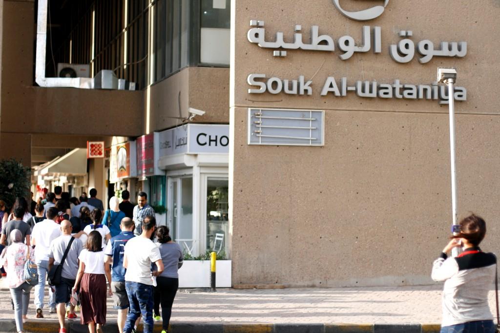 urban tour participants make their way around Souk Al Wataniya