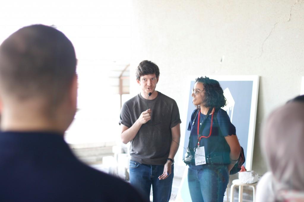Ricardas Blazukas explains the idea behind his artwork; standing next to him is AGi tour guide Lulwa Al Awadhi